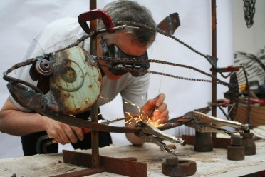 Ecologist Justin Irvine welding.