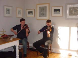 Paul and David Anderson play fiddle at Left Bank Tarland.