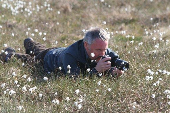Matthew Dalziel taking photographs in cotton grass.